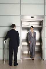 Businesspeople Using Office Elevator