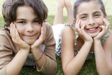 Boy and Girl Lying on Lawn
