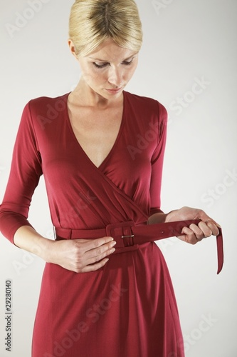 Woman Adjusting Belt