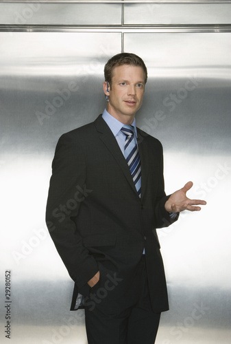 Businessman Using Wireless Headset