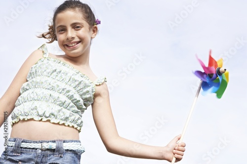 Girl Playing With Pinwheel
