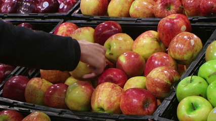 Woman Selecting Apples In Produce