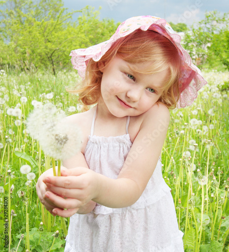 little girl with dandelions