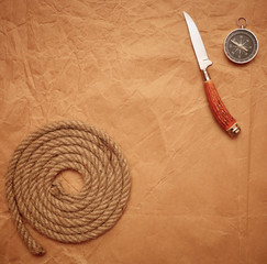 hunting knife, rope and compass