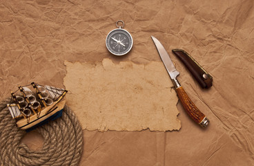 adventure decoration with compass on old paper