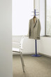 Suit jacket on coat stand in corner of office