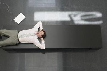 Tired Businessman Lying Down on Desk