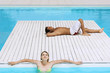 Couple Relaxing at Swimming Pool, high angle view