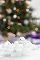 Plate of christmas baubles, close up