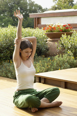 Young woman practising yoga, portrait