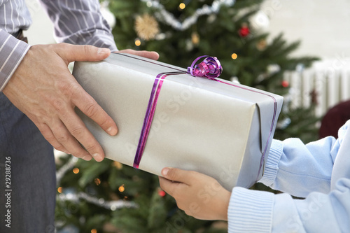 Father and Son Exchanging Gifts, close up of hands