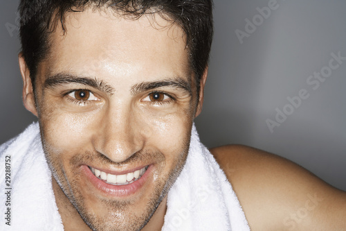 Sweaty Man with towel around shoulders, portrait, close up