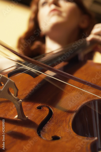 Woman Playing Double Bass, view from below, close-up