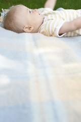 Baby Lying on Blanket