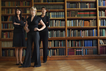 Three lawyers in library, standing