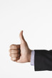 Man making thumbs-up sign against white background, close up of hand