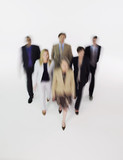 Group of businesspeople walking, blurred effect