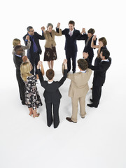 Group of Businesspeople in a circle, holding hands