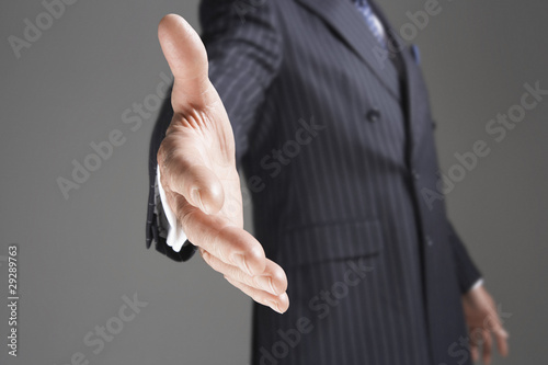 Businessman Offering Hand, mid-section