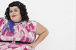 Overweight Woman posing with hands on hips, portrait