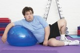 Overweight Man Doing Gymnastics