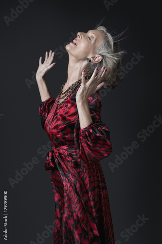 Senior Woman with Hands in Air