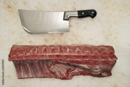 Cleaver and Raw Meat on Countertop, view from above