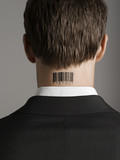 Young man with bar code tattoo on his neck, back view