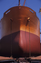 Large, Bronze and red ship in Dry dock