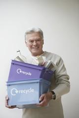 Senior Man Carrying Recycling Bin
