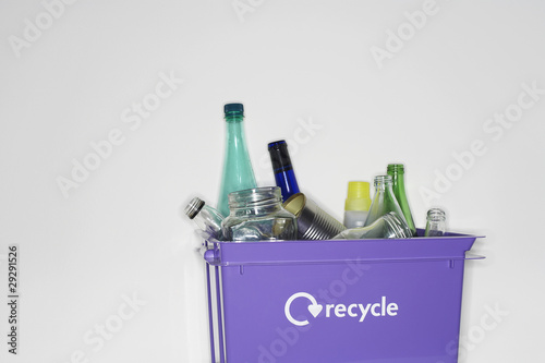 Recycling container filled with empty jars and bottles