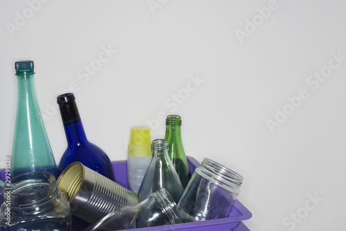 Empty bottles and cans in container, close-up