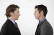 Businessmen face to face, on white background