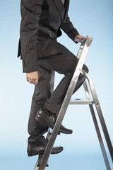 Businessman ascending corporate ladder