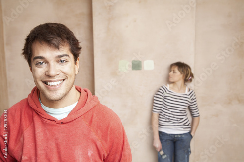 Couple choosing paint colours in unrenovated room