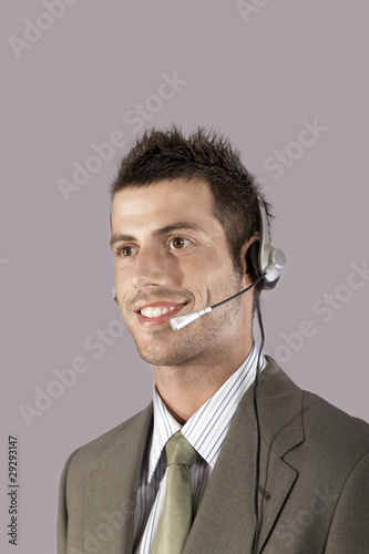 Businessman wearing headset, portrait