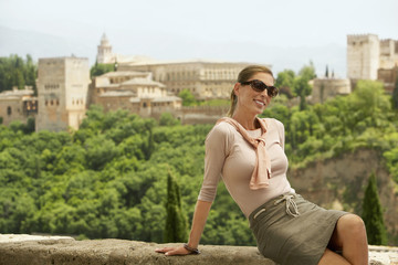 Tourist Relaxing on City Wall, Granada, Spain, portrait