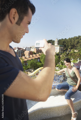 Young man taking photo of woman
