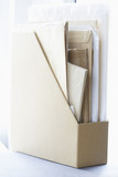 Box file filled with papers and envelopes