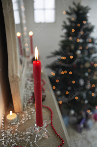 Candles Burning on mantelpiece, close up