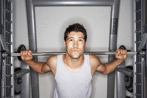 Man struggling to lift Weights on weight machine