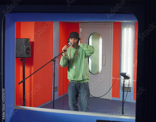 Young man singing in studio