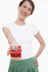 Woman offering small gift wrapped present
