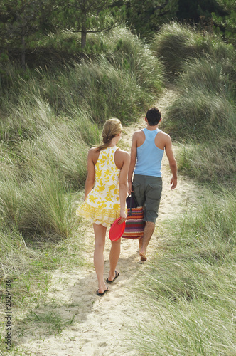 Couple Leaving Beach on Trail, high angle view, back view