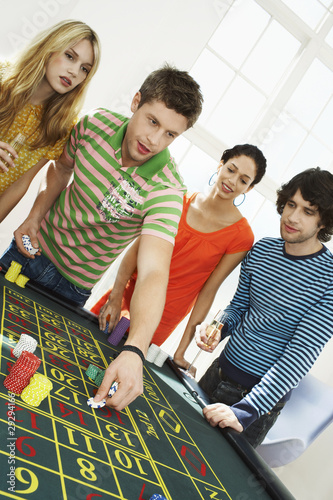Friends Gambling on roulette table