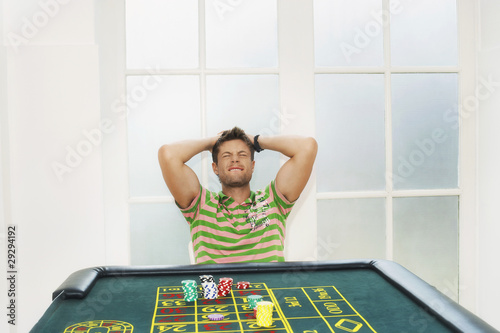 Young Man losing on roulette table