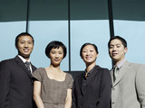 Confident Businesspeople group portrait, low angle view