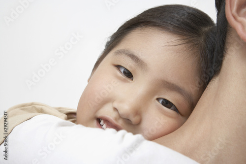 Smiling Young Girl on Father's Shoulders, close-up