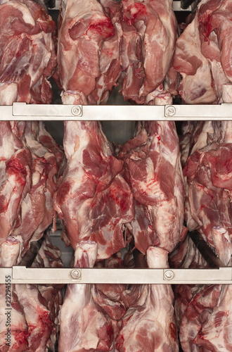 Raw Meat Hanging on Rack