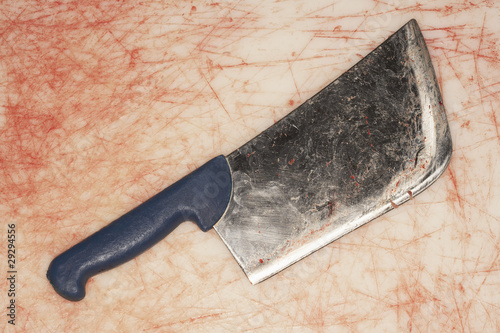 Bloody Cleaver on Stained Countertop, view from above